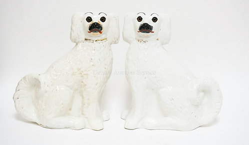 PAIR OF PORCELAIN STAFFORDSHIRE SPANIEL FIGURES. 12 1/2 INCHES HIGH. SOME STAINE
