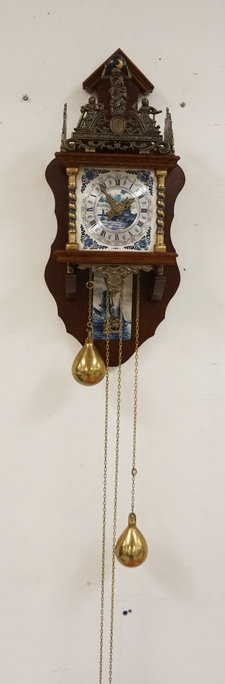 1134_HOLLAND DELFT WALL CLOCK WITH ORNATE METALWORK AND DELFT TILES. 24 X 9 3/4
