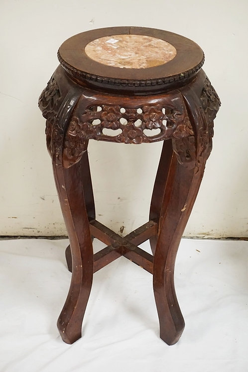 CARVED ASIAN STAND WITH AN INSET MARBLE TOP. 24 INCHES HIGH.