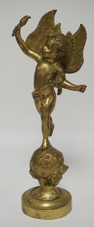 BRASS SCULPTURE OF A CHERUB WITH A TORCH STANDING ON A SPHERE. 16 3/4 INCHES HIG