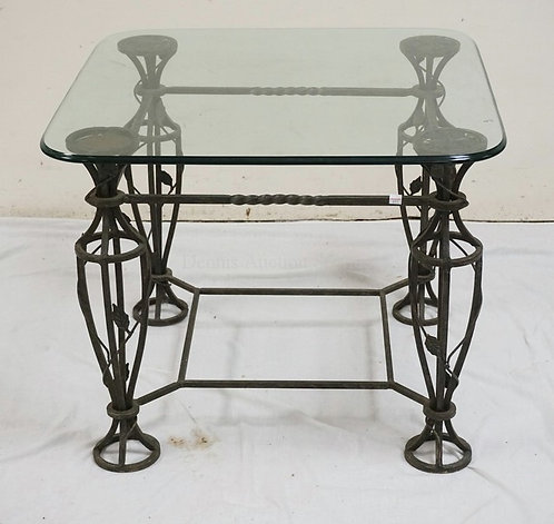 WROUGHT IRON TABLE WITH A GLASS TOP. MISSING ONE MEDALLION UNDER THE GLASS. 30 1