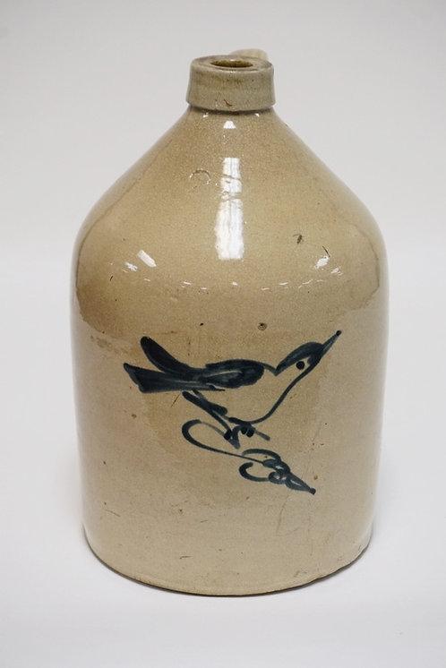 FULPER STONEWARE JUG. BLUE DECORATED WITH A BIRD. 2 GALLON. 13 3/4 INCHES HIGH.