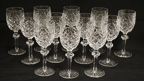 SET OF 12 WATERFORD CRYSTAL WINE GLASSES. 7 1/8 INCHES HIGH.