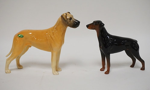 2 BESWICK, ENGLAND DOGS. ONE HAS ORIGINAL LABEL. TALLEST 6 3/4 IN