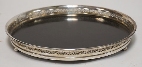 SERVING TRAY WITH A STERLING SILVER RETICUATED FRAME. 12 3/4 INCH DIA.