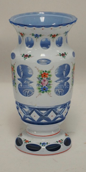 CASED WHITE CUT TO BLUE GLASS VASE DECORATED WITH HAND PAINTED FLOWERS. 6 5/8 IN