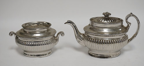 ANTIQUE ENGLISH SILVER LUSTER TEAPOT AND SUGAR BOWL. THE TEAPOT LID HAS REPAIRS.