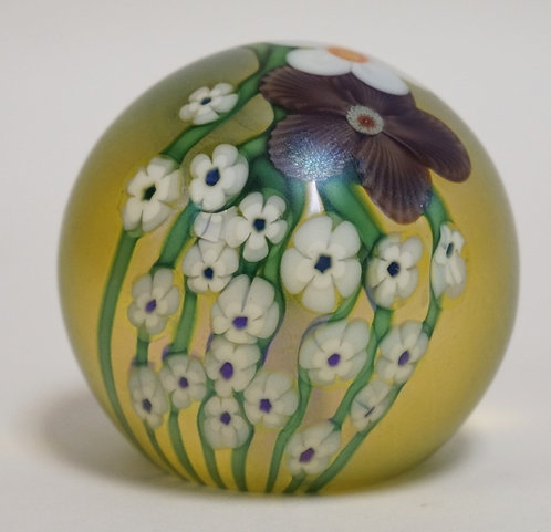 ORIENT & FLUME ART GLASS PAPERWEIGHT DECORATED WITH FLOWERS. 3 INCH DIA.