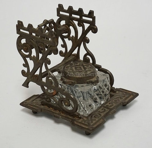 TATUM'S *STANDARD* CAST IRON INKSTAND WITH A GLASS WELL. 4 1/8 INCHES HIGH.
