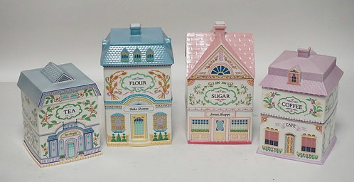 4 PIECE LENOX VILLAGE CANISTER SET. TALLEST PIECE IS 9 1/2 INCHES.