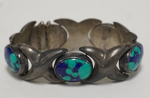 MEXICAN STERLING SILVER BRACELET WITH 4 INSET OVAL STONES.
