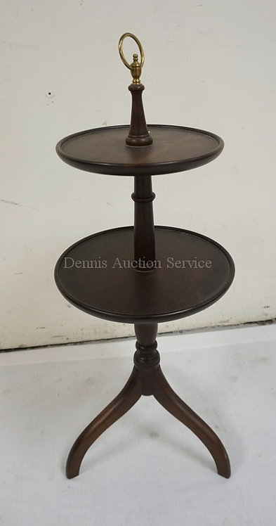 MAHOGANY 2 TIER STAND WITH A BRASS RING HANDLE. 28 1/2 INCHES HIGH.
