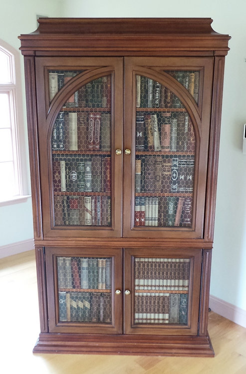 TWO-PIECE ENTERTAINMENT CABINET DECORATED WITH PHONE BOOKS ON PANEL DOORS. TWO-P