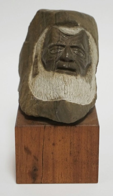 SIGNED CARVED STONE SCULPTURE OF THE BUST OF A MAN MOUNTED ON A WOODEN BASE. 7 1