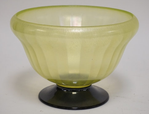 IRIDIZED STRETCH GLASS FOOTED BOWL WITH A RIBBED VASELINE GLASS BODY AND A BLACK