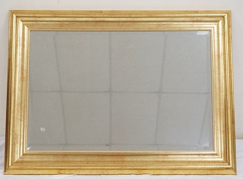 LARGE GOLD GILT MIRROR WITH BEVELED GLASS. 32 1/2 X 44 1/2 INCHES.