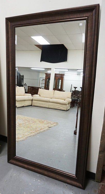 LARGE BEVELED MIRROR IN A MOLDED FRAME. 68 X 38 INCHES.