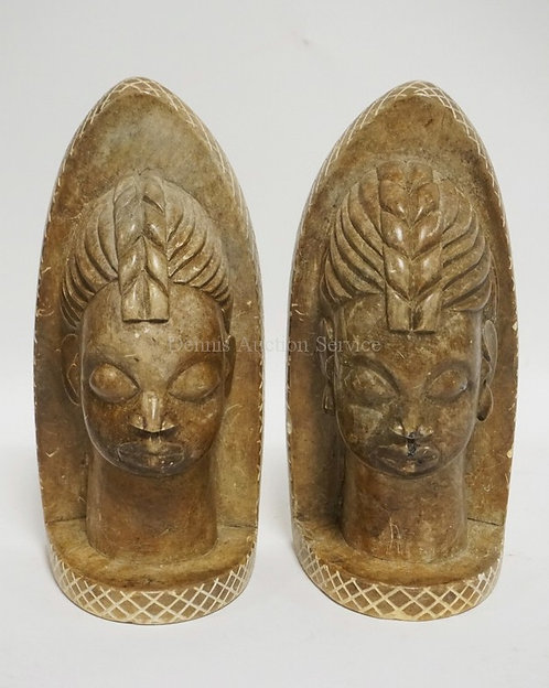 PAIR OF CARVED STONE BOOKENDS. SIGNED MATSSA SIMON. 8 1/2 INCHES HIGH. HAS A FEW