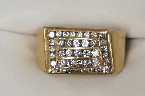 14K YELLOW GOLD RING WITH 39 CHANNEL SET ROUND DIAMONDS ROUND. 6.70 DWT.