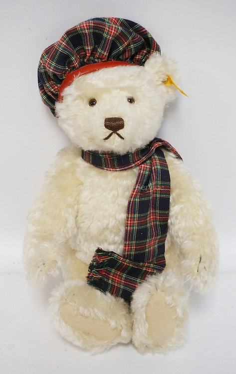 JOINTED STEIFF GROWLING BEAR. 13 1/2 INCHES HIGH. HAS THE STEIFF BUTTON AND TAG