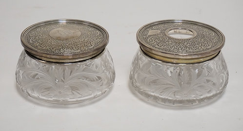 PAIR OF ANTIQUE INTAGLIO CUT GLASS DRESSER JARS WITH STERLING SILVER LIDS. A POW