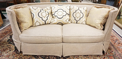 TAYLOR & KING UPHOLSTERED SOFA WITH CURVED ENDS. 59 INCHES LONG. 36 INCHES HIGH.