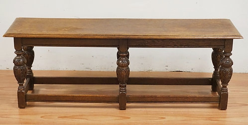 CARVED OAK WINDOW BENCH WITH BALUSTER LEGS. 54 X 15 INCH TOP. 18 1/2 INCHES HIGH