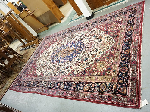 HAND WOVEN ORIENTAL RUG MEASURING 12 FT 2 INCHES X 7 FT 8 INCHES. HAS WEAR.