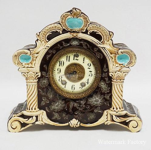 UNUSUAL PORCELAIN MANTEL CLOCK WITH MAJOLICA STYLE D�COR. PORCELAIN FACE. CASE I