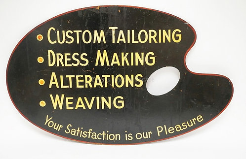 MASONITE TAILOR'S SIGN IN THE FORM OF A PALETTE. 36 1/4 IN X 22 3/4 IN