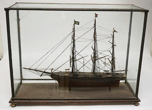 ANTIQUE WOODEN CLIPPER SHIP MODEL IN A GLASS & METAL FRAMED CASE (MISSING 2 FEET