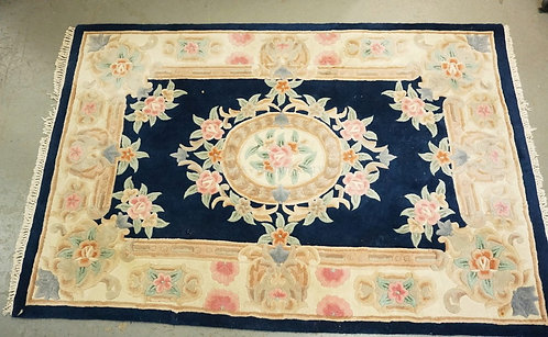 CHINESE SCULPTED THROW RUG MEASURING 4 FT 11 X 7 FT 5 INCHES.
