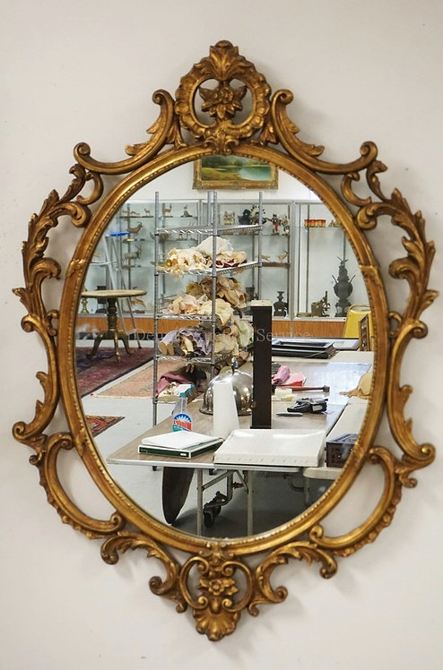 WALL MIRROR IN AN ORNATE GOLD GILT FRAME. 32 1/2 X 45 INCHES.