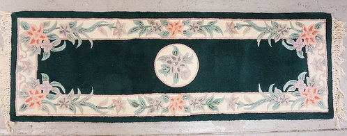 CHINESE RUNNER IN GREEN AND DECORATED WITH FLOWERS. 6 FT X 2 FT.