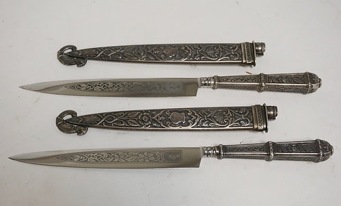 PAIR OF ORNATE SILVER PLATED LETTER OPENERS. 9 1/4 INCHES LONG.