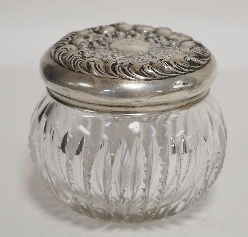 CUT GLASS DRESSER JAR WITH A STERLING SILVER LID. .88 TROY OZ LID. 3 1/2 INCH DI