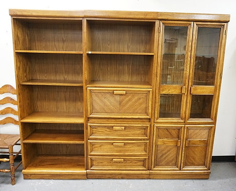 3 SECTION WALL UNIT WITH BOOKSHELVES, A DOUBLE GLASS DOOR CABINET, DRAWERS, AND