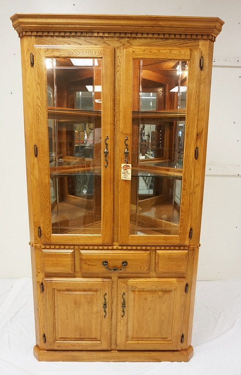 NEW FURNITURE LIQUIDATION, OAK LIGHTED CORNER CABINET WITH MIRROR BACK AND GLASS