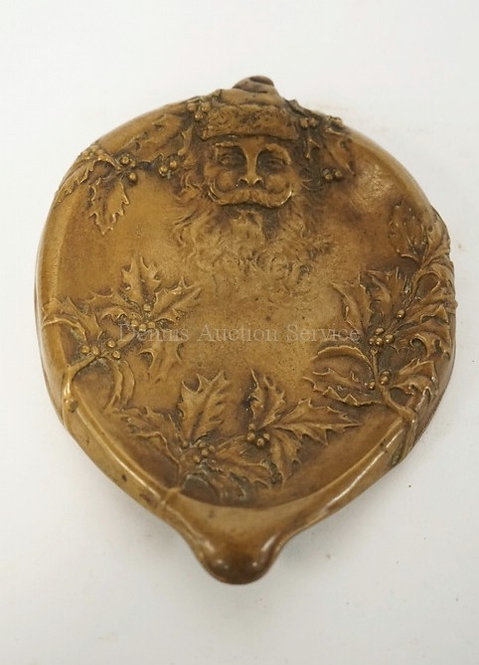 BRONZE DISH WITH RELIEF DECORATION OF SANTA CLAUS AND HOLLY. 5 1/2 X 4 3/8 INCHE
