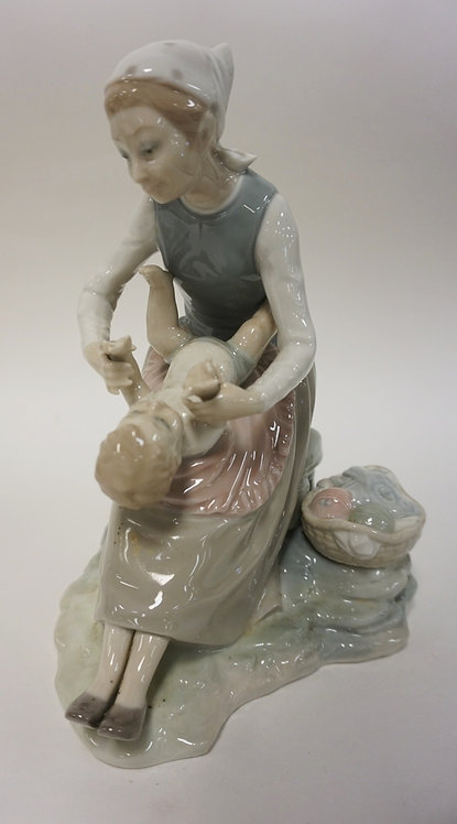 LLADRO NAO WOMAN WITH BABY AND BASKET OF KNITTING. 9 1/4 IN H