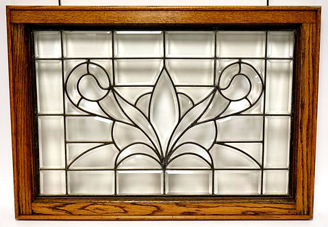 OAK FRAMED LEADED GLASS WINDOW WITH BEVEL CUT GLASS PANES. 34 X 24 INCHES.