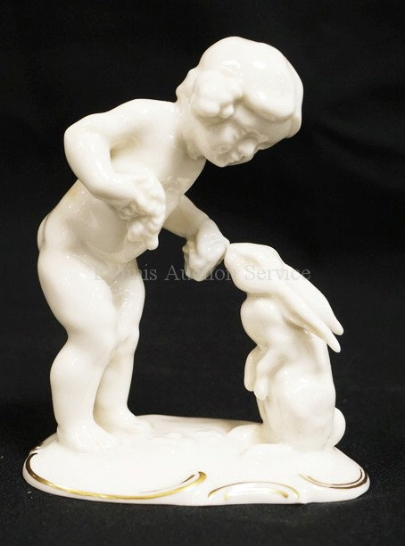 HUTSCHENREUTHER PORCELAIN FIGURE OF A CHILD AND A RABBIT BY *TUTTER*. 4 7/8 INCH