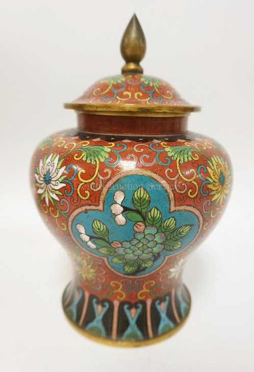 CLOISONNE COVERED JAR WITH STYLIZED FLOWERS AND SCROLLS. 10 1/2 IN H