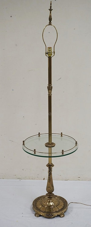 BRASS FLOOR LAMP WITH A GLASS TABLE CENTER HAVING A BRASS GALLERY. 64 INCHES HIG