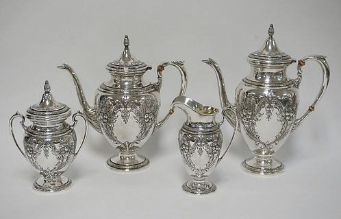 STERLING SILVER TEA & COFFEE SET BY ELLMORE IN THE *CHAMPLAIN* PATTERN. HAND CHA