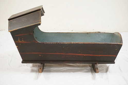 ANTIQUE GRAIN PAINTED AND STENCILLED CRADLE. APPROX 43 INCHES LONG.