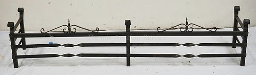 WROUGHT IRON FIREPLACE FENDER MEASURING 64 1/2 INCHES WIDE.