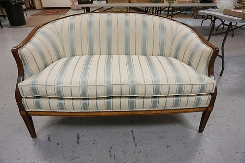 CURVED BACK UPHOLSTERED LOVESEAT. 53 IN WIDE