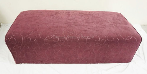 UPHOLSTERED OTTOMAN MEASURING 51 INCHES LONG.