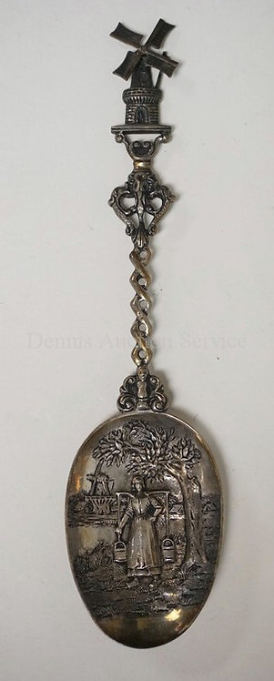 DUTCH .833 SILVER SPOON WITH RELIEF DECORATION OF A WOMAN CAYYING BUCKETS WITH A